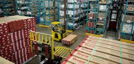 Forklift moving items in a warehouse