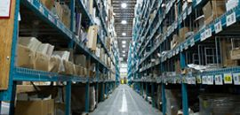 Large warehouse with many boxes on the shelves